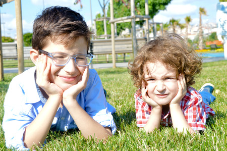 bespectacled man: The facial expressions of cute brother of 11 and 4 years