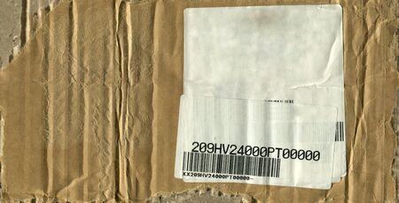 creased: Worn and creased cardboard glued onto barcode Stock Photo