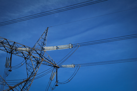 megawatt: High voltage electricity cables datail over a clean blue sky