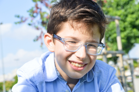 bespectacled: 11 year old bespectacled boys facial expression Stock Photo