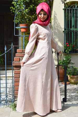 stylishly: Beautiful muslim young woman very stylishly dressed Stock Photo