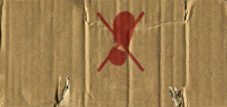 creased: Worn creased cardboard and a warning sign