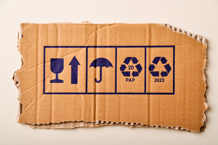 torn cardboard: A torn cardboard and symbols, with all the details