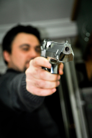 chrome man: A man and chrome plated pistol Stock Photo