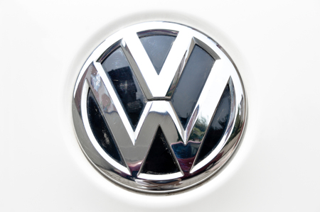 chrome metal: Close-up Volkswagen logo. Chrome metal Editorial