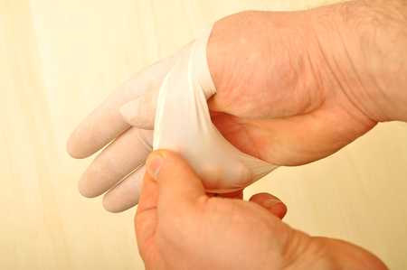 surgical glove: Male doctor and hygienic white surgical glove