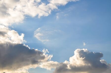 White and gray, fluffy clouds in blue sky Stock Photo