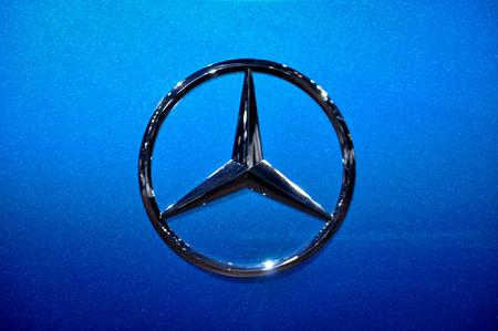 chrome: Close-up Mercedes logo. Chrome metal