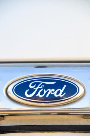 chrome: Close-up Ford logo. Chrome metal Editorial