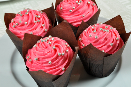 Wonderfully decorated pink yummy cupcakes in plate