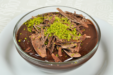 Delicious chocolate pudding and chocolate pieces in the plate