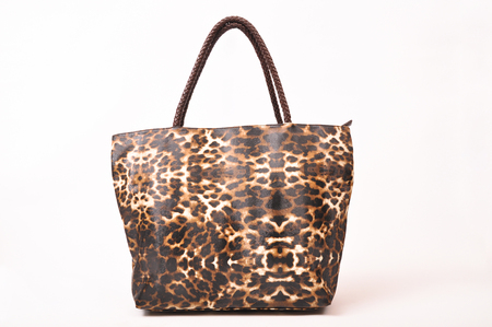 Leopard patterned womens bag on a white background