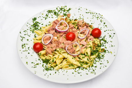 Pasta with tuna and vegetables isolated on white background
