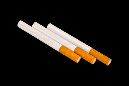Typical filter cigarette isolated on black background