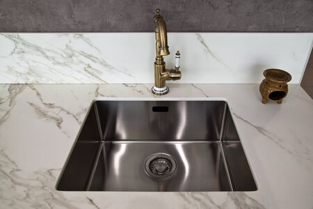 Interior of luxurious modern kitchen and ceramic sink and tap Stock Photo