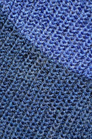 Pattern fabric made of wool. Handmade knitted fabric blue wool background texture