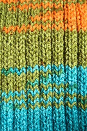 Pattern fabric made of wool. Handmade knitted fabric turquoise and green wool background texture Фото со стока