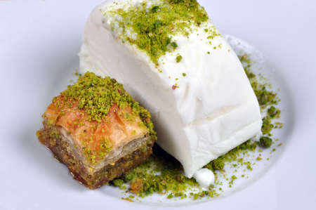 Cut Maras Ice Cream with pistachio Antep Baklava, in white plate Stock Photo