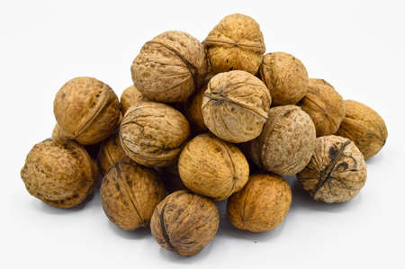 Healthy and nutritious beige brown walnut grains, isolated on white background