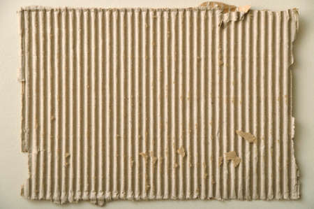 Brown and beige corrugated cardboard, isolated on white background