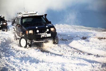 One SUV 4x4 cars go on snowy road, winter season, very cold, Istanbul Turkey, January 1, 2016