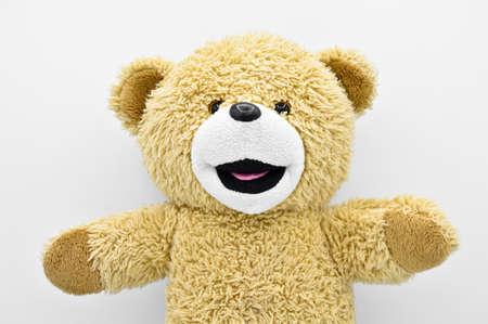 Beige toy plush teddy bear isolated on white background