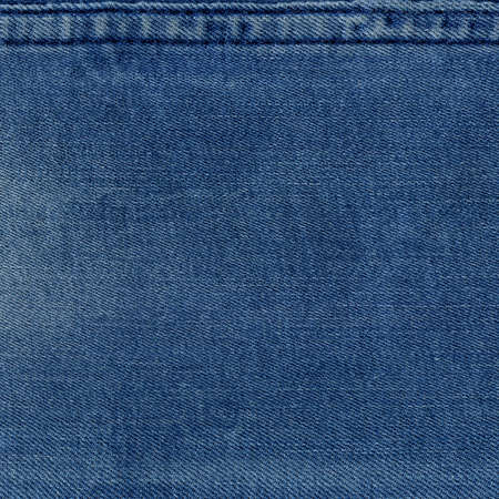 Seam blue denim cotton jeans fabric texture background and wallpaper