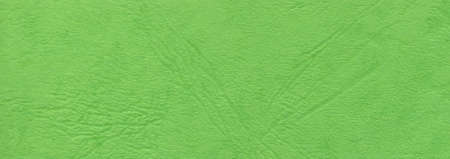 Suitable for background, leather texture surface kraft green paper close-up, can be used for web templates and artworks