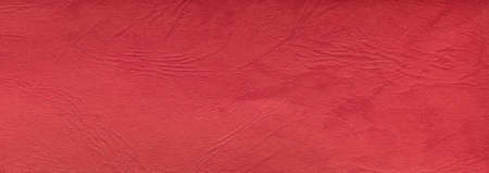 Suitable for background, leather texture surface kraft red paper close-up, can be used for web templates and artworks