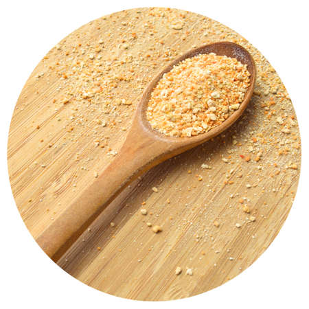 Dried powdered tarhana, homemade soup, in wooden spoon, on cutting board