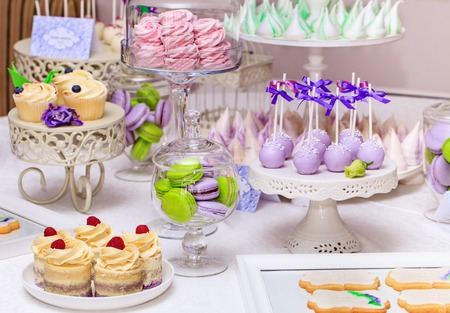 kiss biscuits: Delicious sweet buffet with cupcakes, Sweet holiday buffet with cupcakes and meringues and other desserts Stock Photo