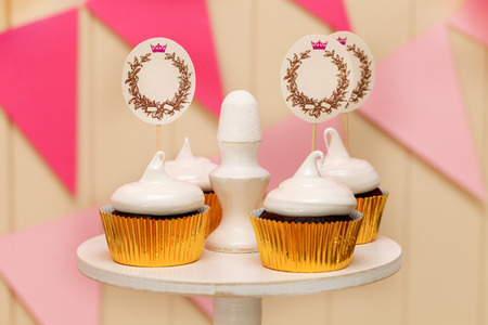 candy buffet with cupcakes with paper labels for text photo