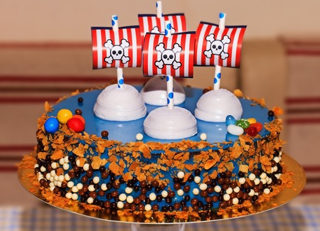 kiss biscuits: Blue birthday party cake for a child with decoration on top Stock Photo