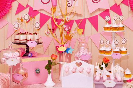 dessert stand: Delicious sweet buffet with cupcakes, Sweet holiday buffet with cupcakes and meringues and other desserts Stock Photo