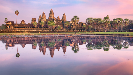 temple: Angkor Wat temple at dramatic sunrise reflecting in water