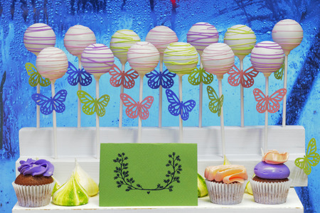 cakestand: Delicious sweet cake-pops on sticks and cup-cakes Stock Photo