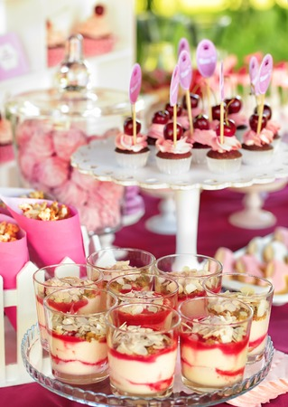 cakestand: Delicious sweet buffet with cupcakes, tiramisu glasses and other desserts
