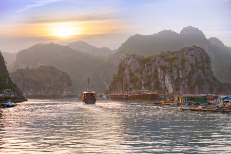 Dreamy sunset among the rocks of Halong Bay, Vietnam