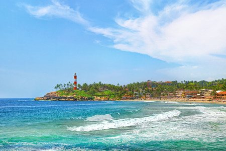 kovalam: Kerala province beach in India with a vivid lighthouse in the ocean