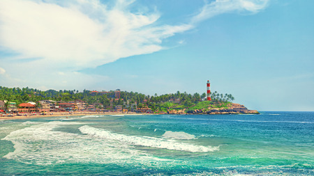 kovalam: Kerala province beach in India with a vivid lighthouse in the ocean. Creative filter affect Stock Photo