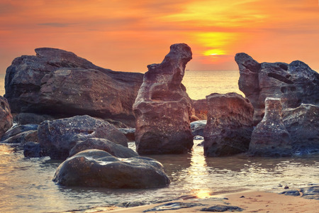 Vivid sunset amongst  fantastic rocks in  the ocean Banco de Imagens