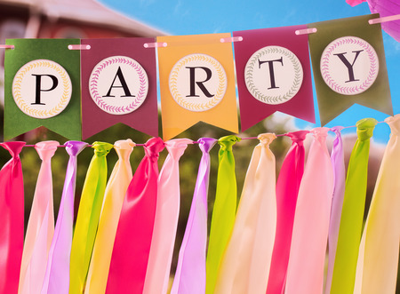 swag: Colourful festive swag banner with ribbons for party decoration