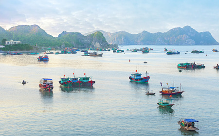 gentle dream vacation: Traditional blue wooden fishing boats in the ocean, Asia