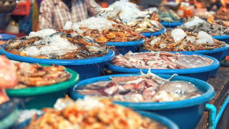 malaysia culture: Traditional asian fish market stall full of fresh seafood