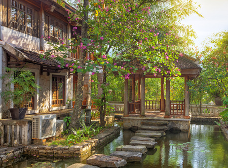 garden pond: asian tropical garden with traditional architecture, Vietnam
