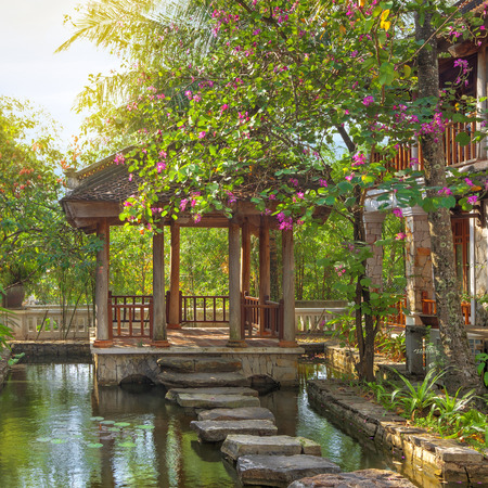 summerhouse: asian tropical garden with traditional architecture, Vietnam