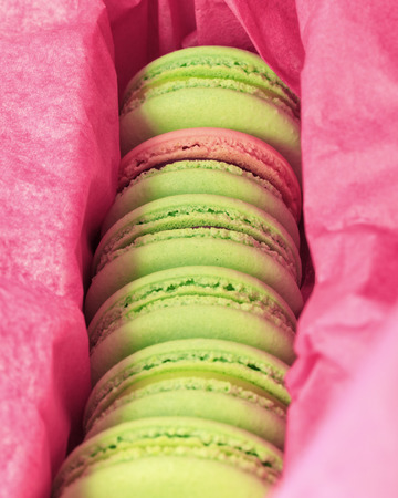 Delicious sweet buffet with colorful macarons in a box photo