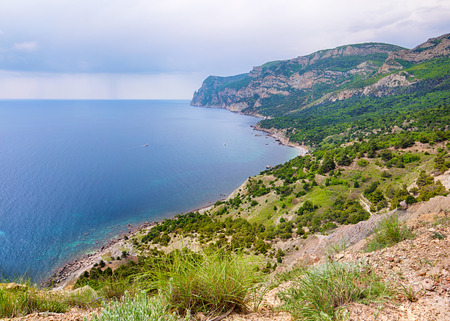 Rocky beach of Crimea, view over the sea photo