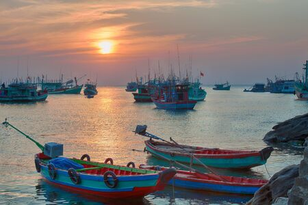 india fisherman: Traditional blue wooden fishing boats in the ocean, Asia