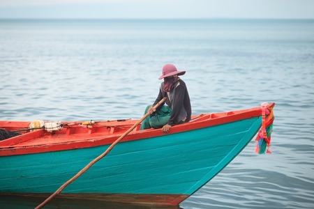 Traditional asian fishing. Cambodian man on the fishing boat
